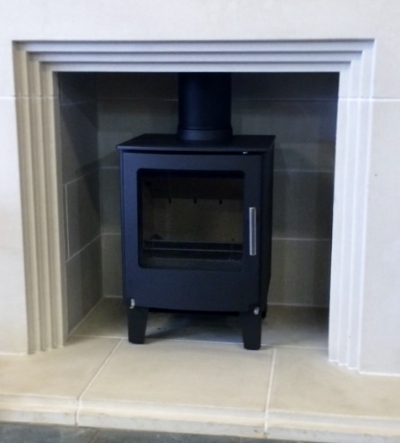 Series 1 sitting in a Portland Stone Haddenstone fireplace