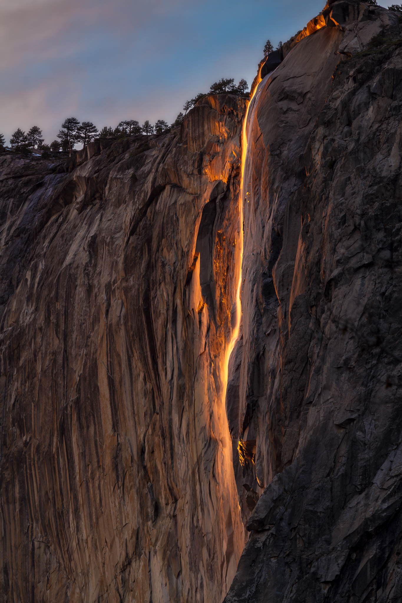 This is horsetail falls as the setting sun changes the otherwise normal waterfall to a bright orange firefall