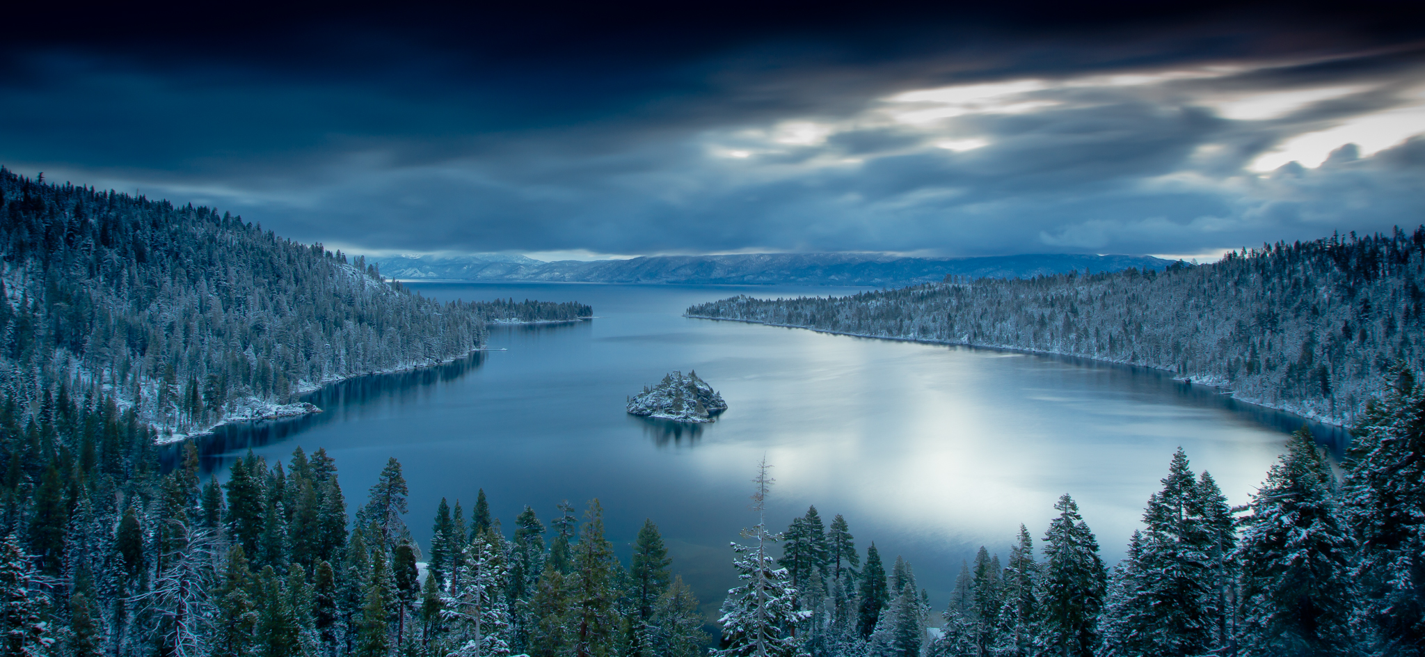 emerald bay in lake tahoe is the main attraction for photographers. This was made before sunrise while the moon was still out. The long exposure provides a silky smooth surface for the water, and provides the movement in the clouds.