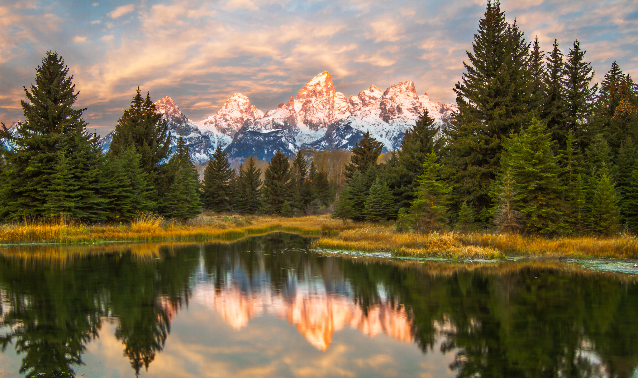 this images was made at schwabacher landing in Grand Teton National park at sunrise. A ND Grad is highly recommended as the sun light the mountain peaks way before it reaches the forests below.