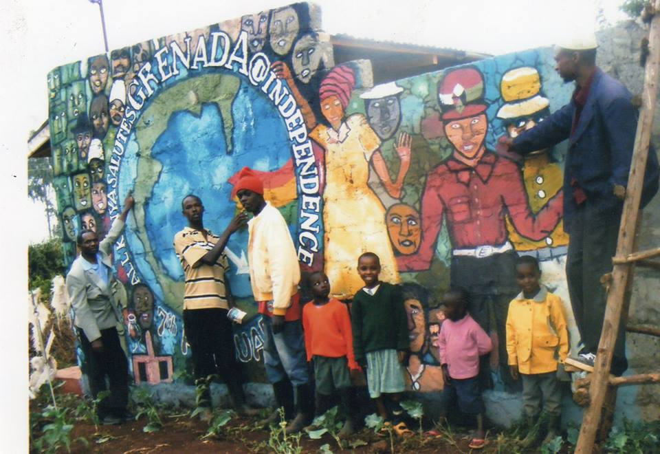 Community members in Ngecha, Kenya create a wall mural for the people of Grenada (February 27).