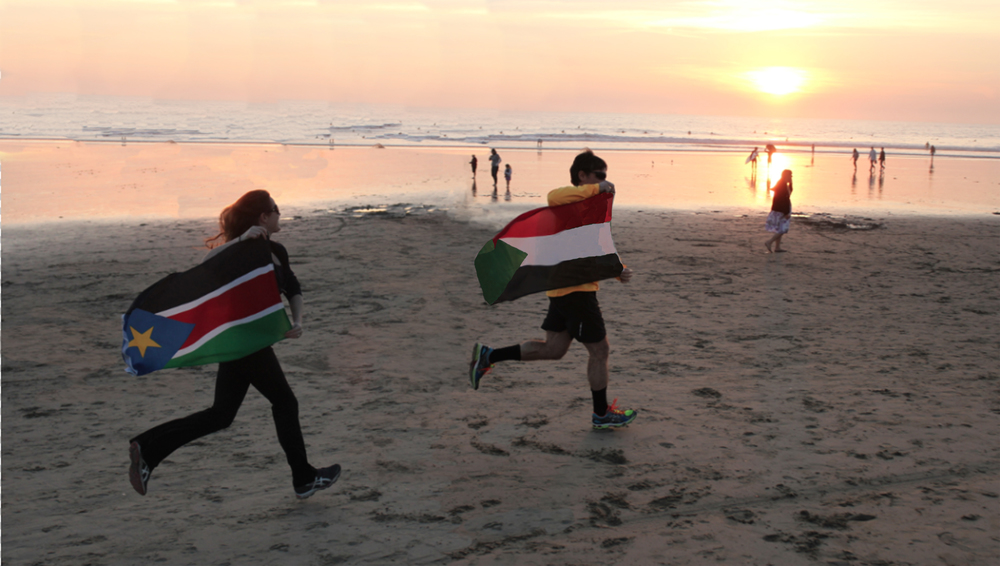 "We read ""Running for My Life: One Lost Boy's Journey from the Killing Fields of Sudan to the Olympic games"" and run with the flags of Sudan and South Sudan (Jan 1)."