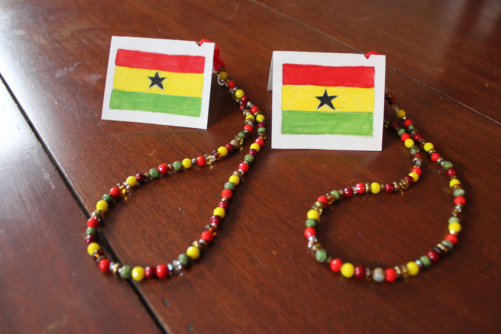 Heather creates necklaces with the colors of the Ghana flag and sends them to friends on Ghana's independence day (March 6).