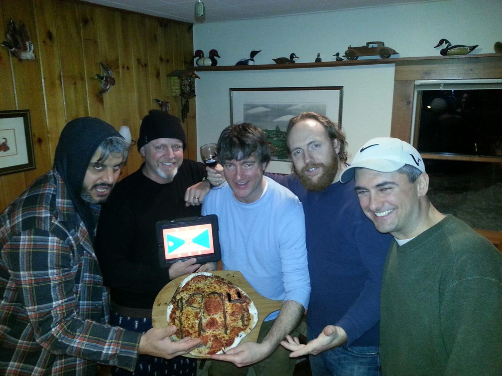 Brian and friends create a pizza party to honor the people of Grenada on Grenada's independence day (Feb 7).
