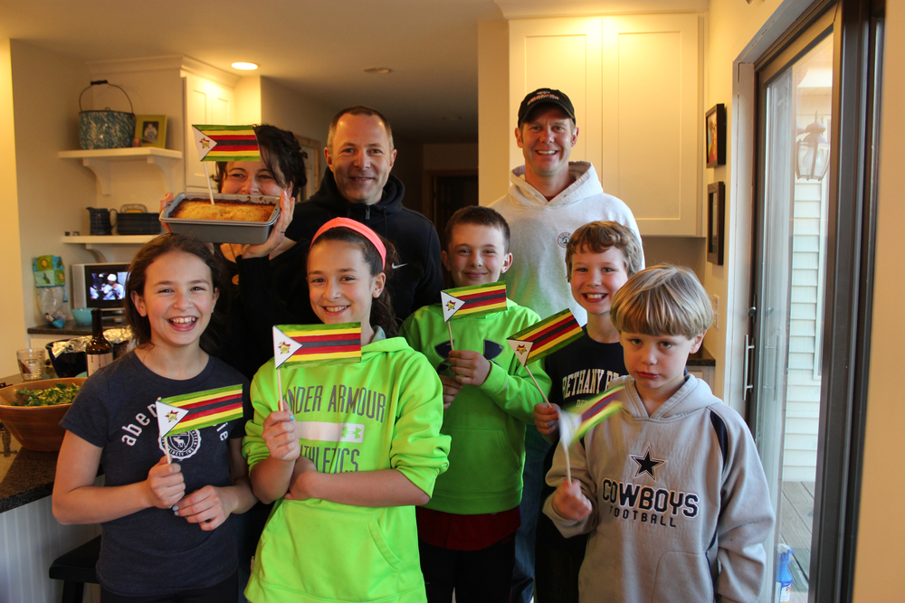 Megan, Chip, Dina, Steve, and their kids host a special dinner on Zimbabwe's independence day (Apr 18). Brian bakes a traditional orange loaf cake.