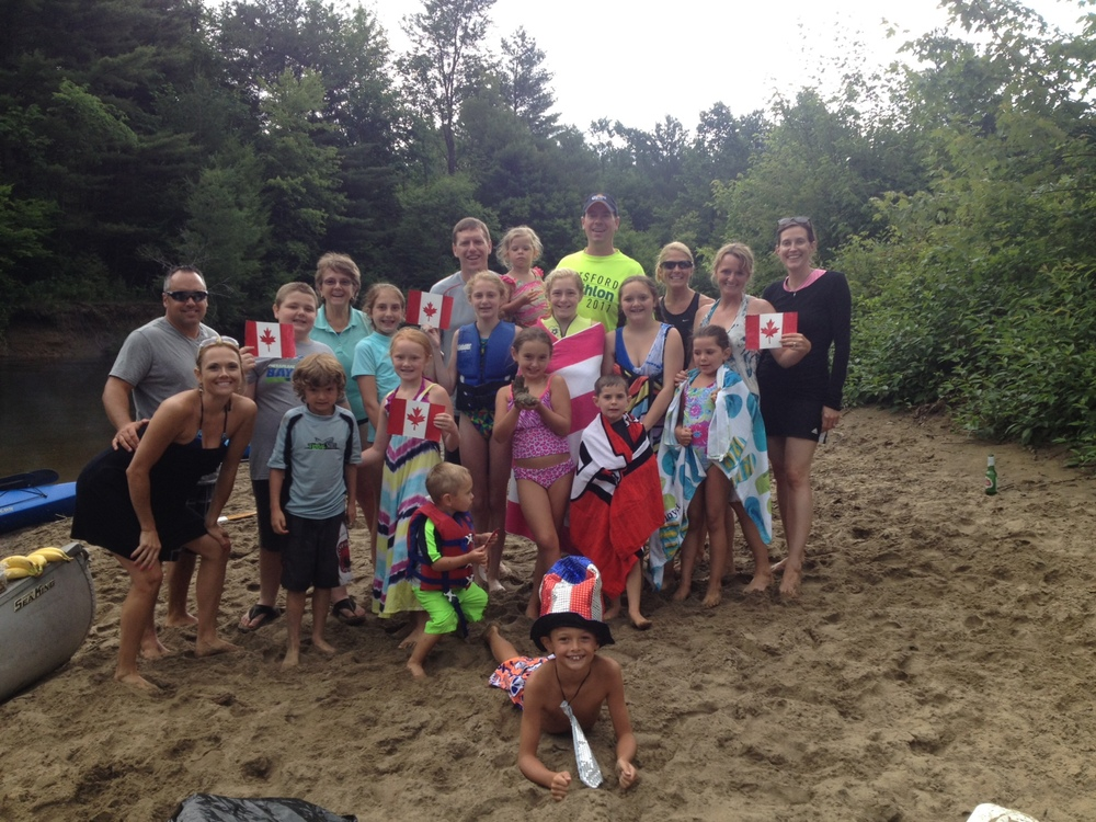 Cousins in the United States celebrate Canada's National Day (July 1) with a tubing trip down the river.