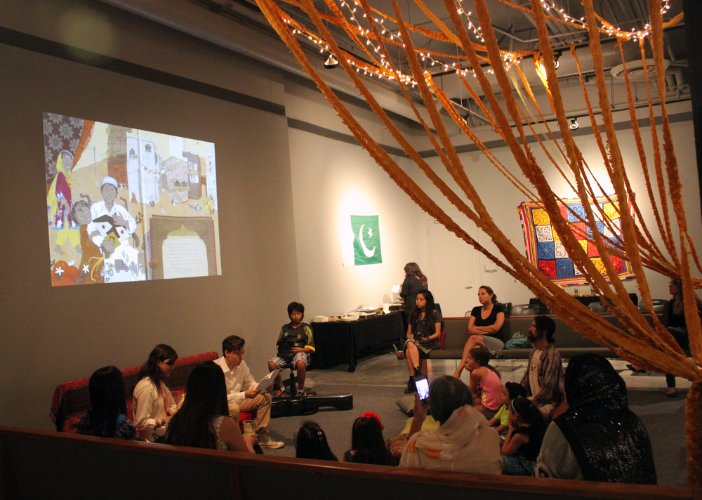 We create a tri-lingual book reading for kids at the Grand Central Arts Center in California (USA), with food, music, craft display, and henna table, on Pakistan's independence day (Aug 14).