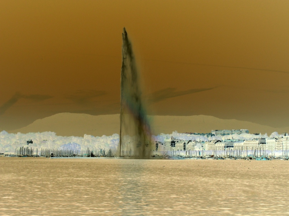 Tom Bogaert, a Beligian national artist living in Switzerland, creates a memorial for the Iraqi people on Iraq's independence day (Oct 3) by inverting the colors of Geneva's famous fountain to resemble an oil geyser in the Iraqi desert.