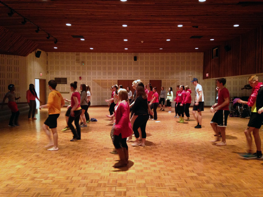 Heather Roffe leads a special unit on Ugandan dancing traditions to her dance students at Nazareth College (USA) on Uganda's independence day (Oct 9).