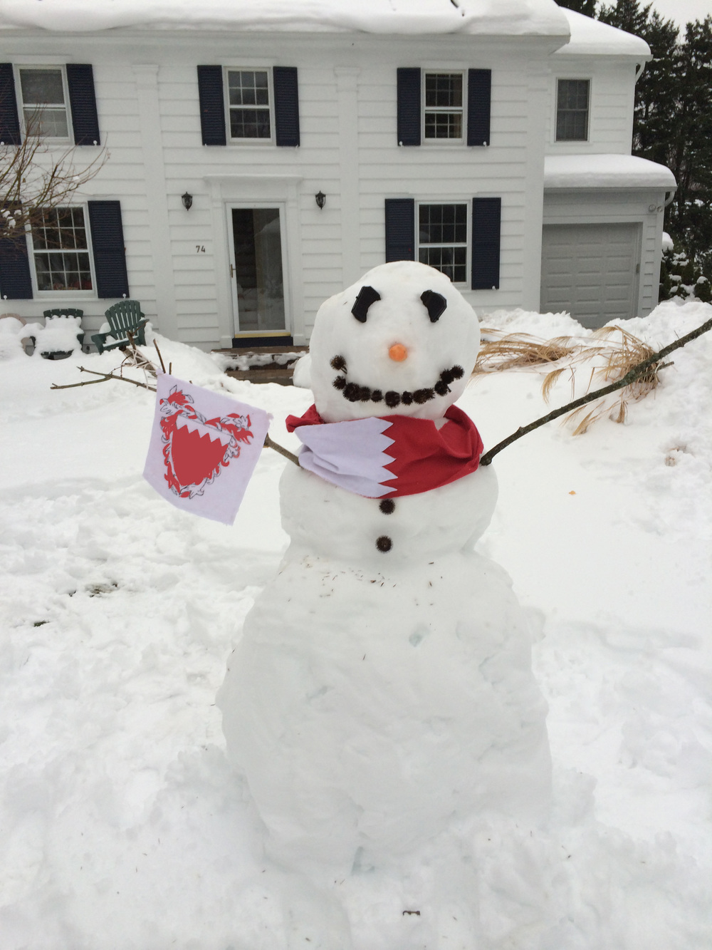 Heather makes a snowman in the United States to say hello to the people of Bahrain on Bahrain's independence day (Dec 16).