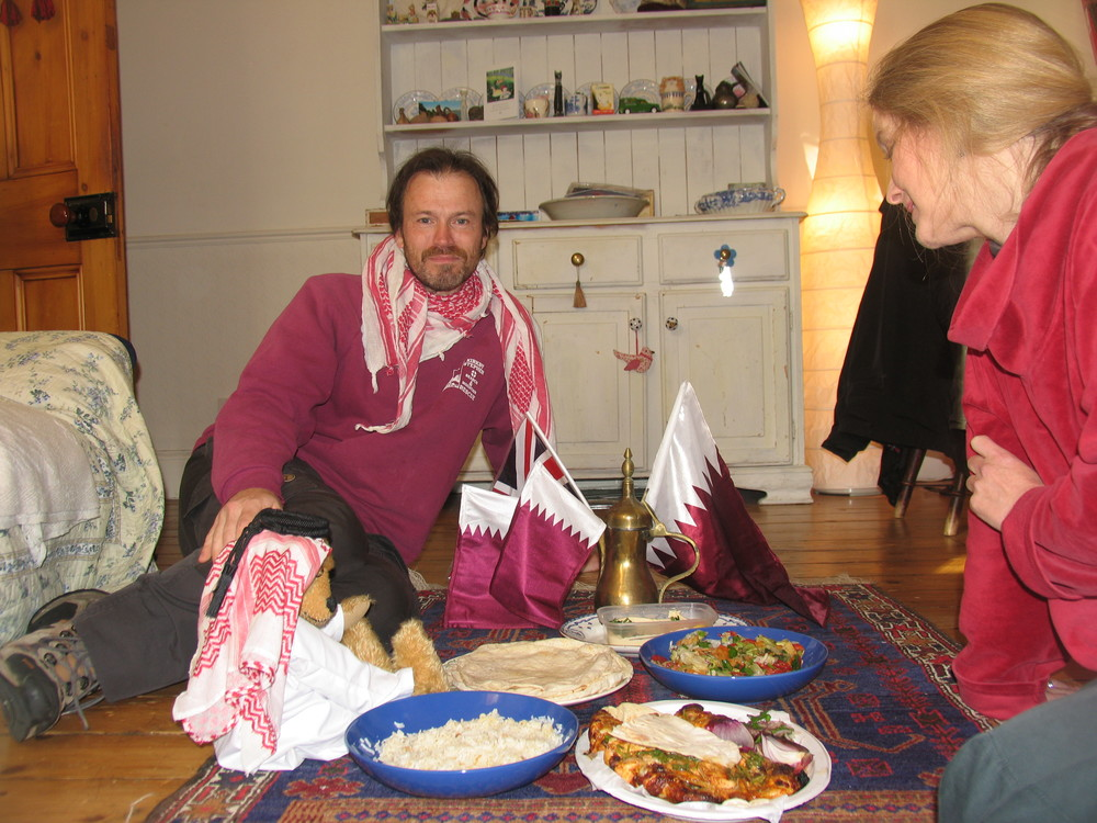 In England, Frank invites friends to his home to celebrate Qatar's National Day (Dec 18).