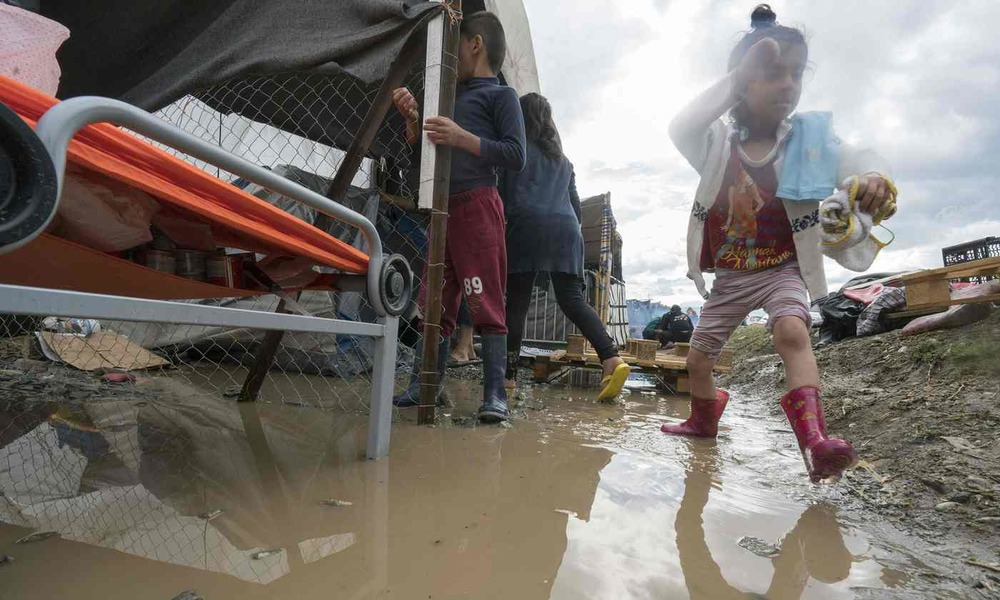 A young girl plays in a refugee camp at the Greek-Macedonian border. Poor drainage in makeshift settlements can spread disease but 'nobody owns that problem', says the Humanitarian Innovation Fund. Photograph: Joe Klamar/AFP/Getty Images