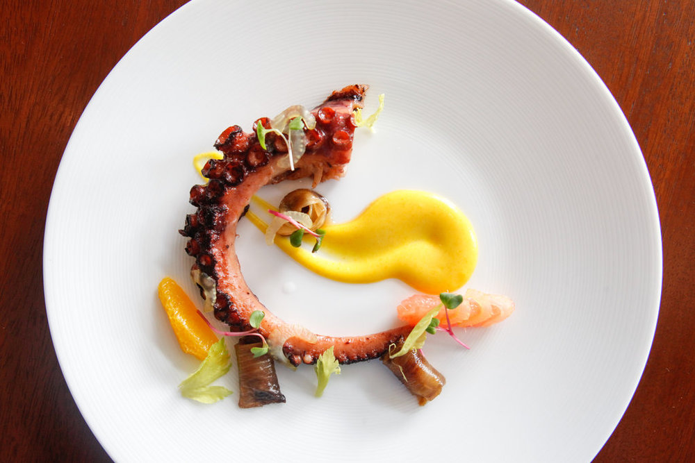 Charred octopus with citrus, caramelized endive and chorizo vinaigrette at Colicchio & Sons.    Danny Ghitis for The New York Times