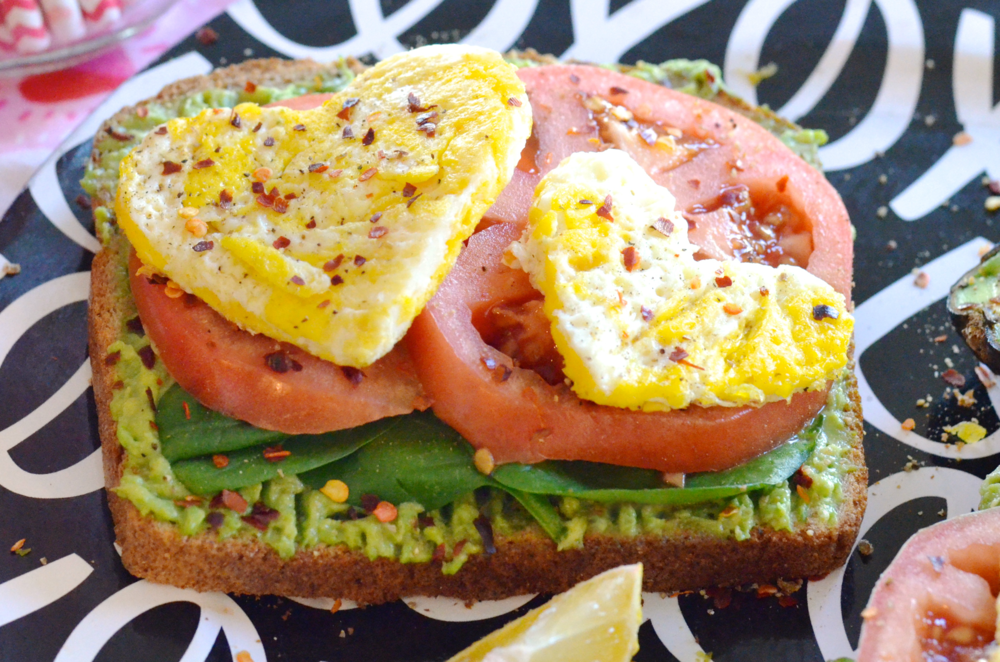 Avocado, Spinach, Tomato and Egg Breakfast Sandwiches with a Colorful Fruit Platter