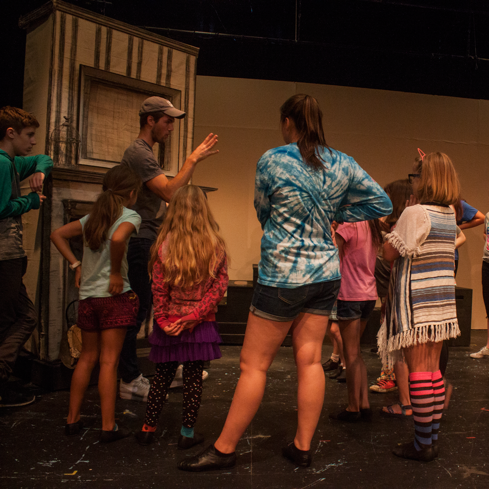 Director Ty Molbak works with Chimney Sweeps during Down the Chimney choreography. Photo by Kathryn Lynn Morgen