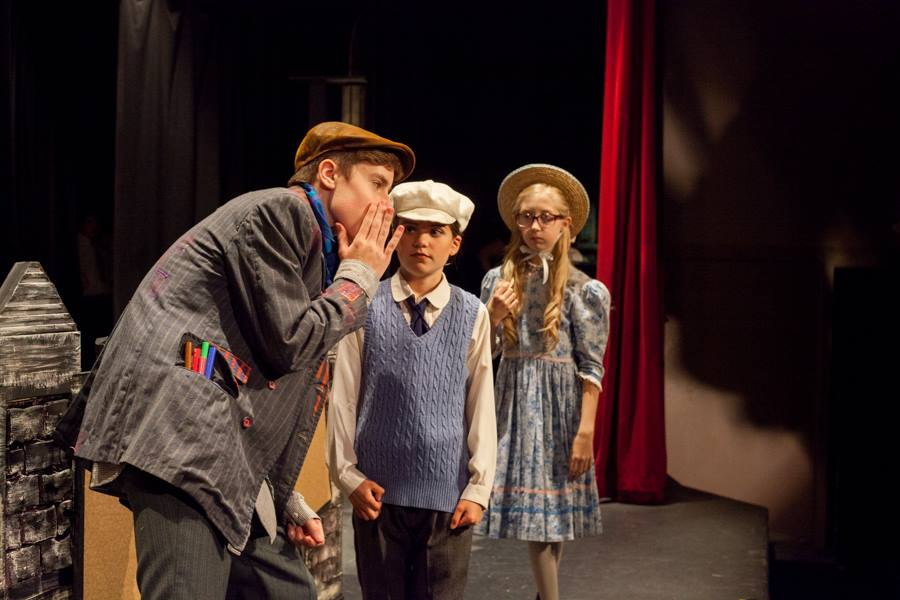 Bert (Callum Cassée whispers to Michael (Annabella Harrison) and Jane (Chloe Cranch) in WCT's Summer Classic 2017, Mary Poppins - Photo by Lucy Brown