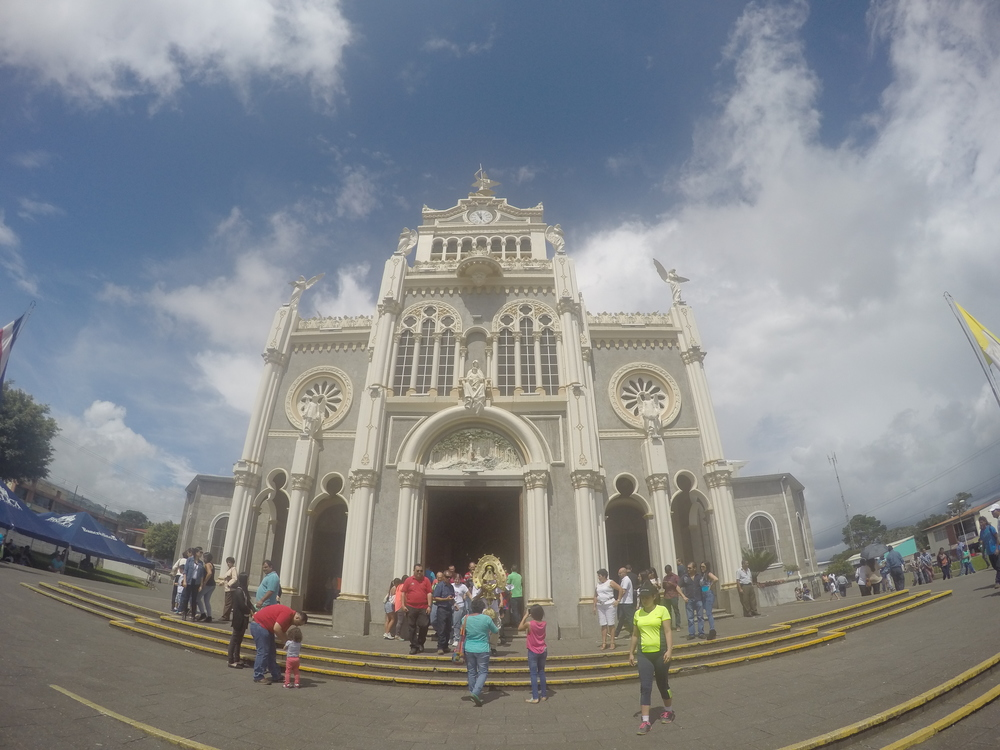 """The Basilica. The gold statue was the """"virgin angel"""" that people were wanting to touch."""