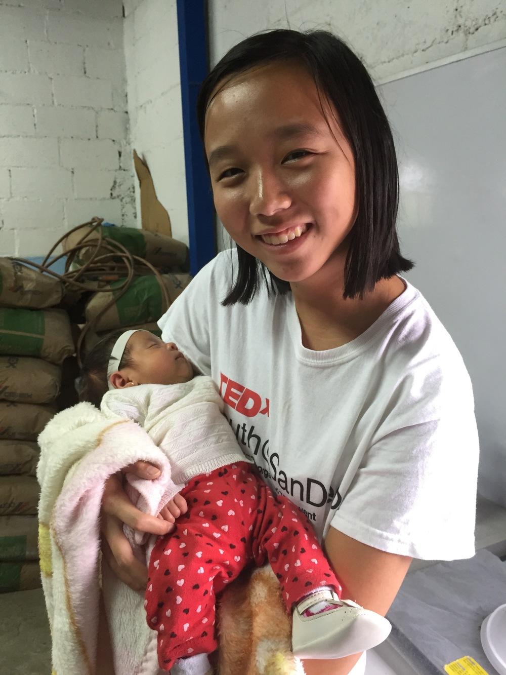 Karina holding a baby