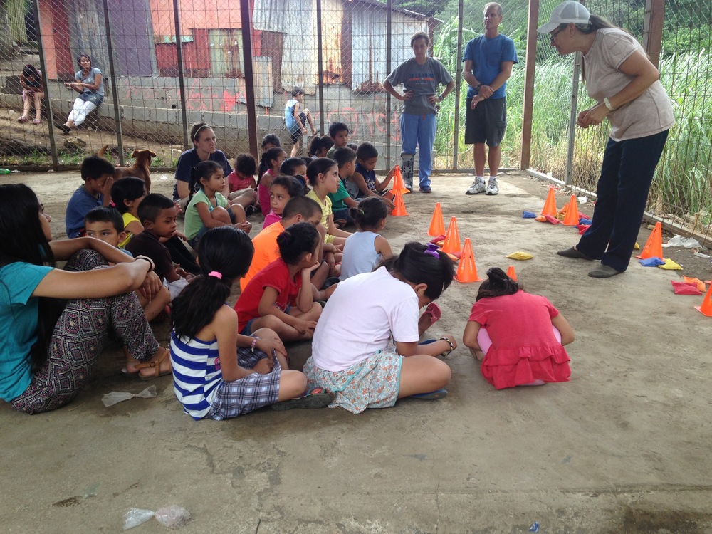 The ministry leader teaching the children about Jesus and the fisherman