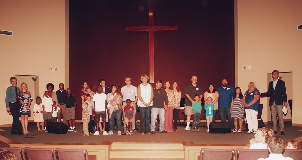 From left to right: Jeremiah & Lauren Bedford, Coy & Michelle Malone and kids, Joe & Lauren Relyea and kids, Brian & Lucy Loftus and kids, Janet Williams, Scott & Beth Slocum, Nita Critzer, Vince & Rosemary Hallman (she's on the far right), and Clyde & Jessie Hallman and kids. Praise the LORD!