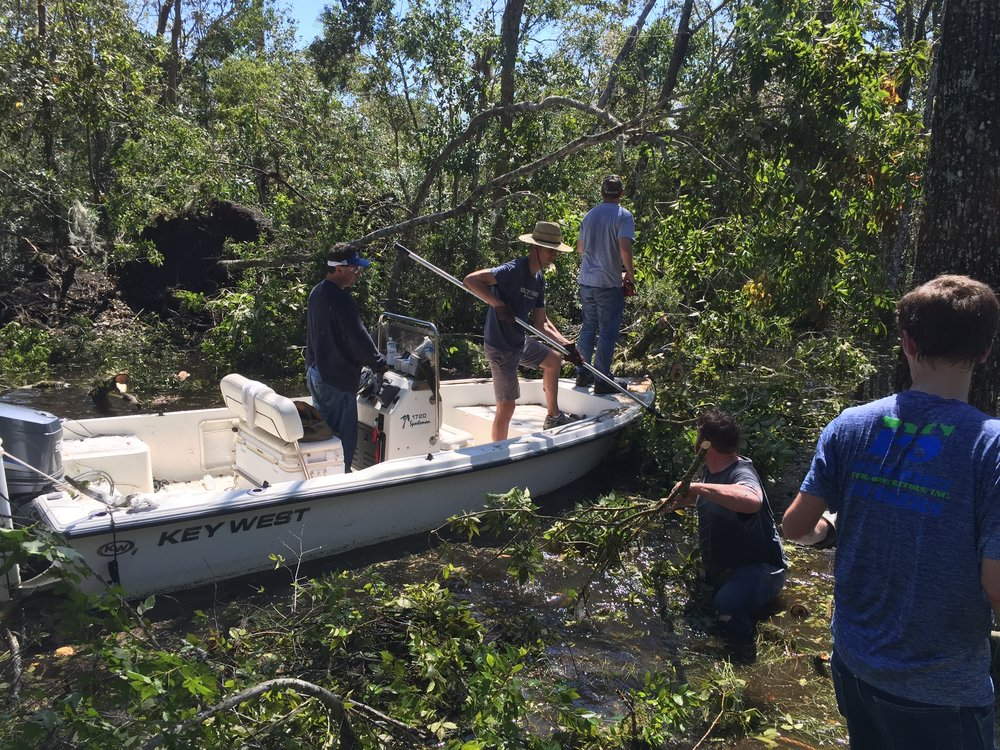 Helping a new Cross Creek family with hurricane cleanup