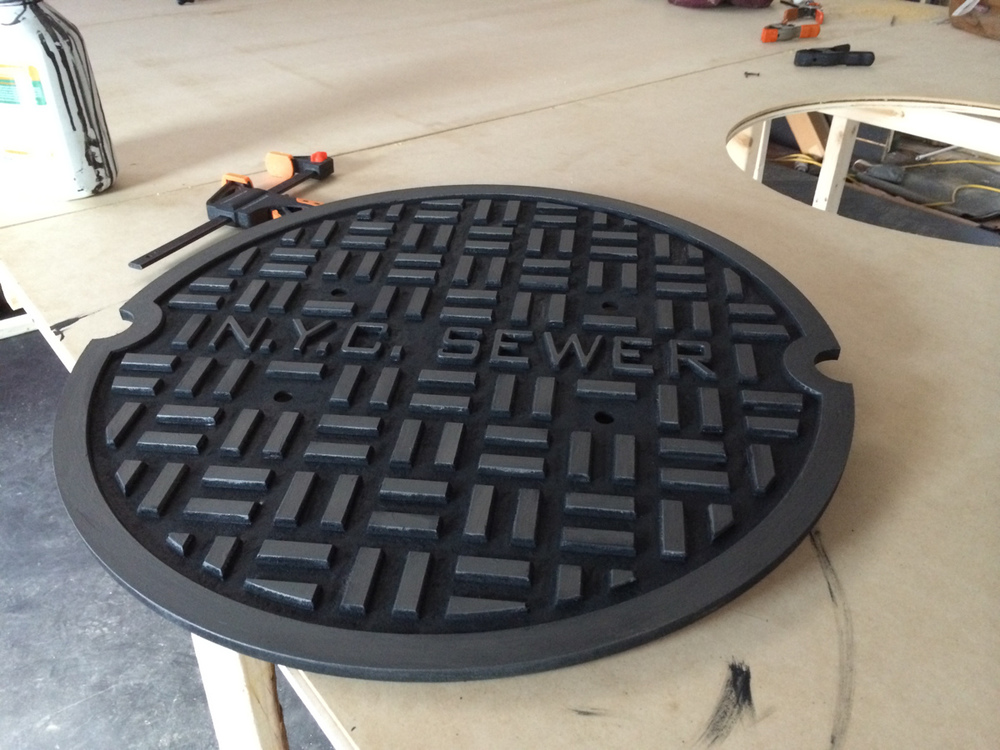 Painted MDF sewer cover replica