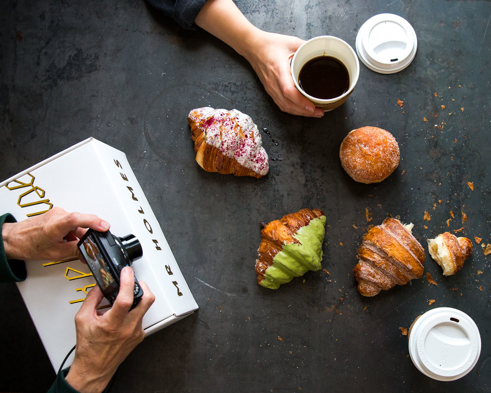 Above: Our first impromptu food styling / food photography shoot featuring Mr. Holmes Bakehouse pastries brought by Julianna.  Below: Alex and Sylvie compose the perfect top down shot of Mr. Holmes Bakehouse pastries. / Ellie very patiently adding a human element into the scene.