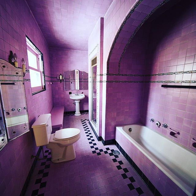 What is better than an all pink bathroom?! An all pink bathroom with original Grueby tile!!! #ourhouse #venue #chicago #edgewater #weddings @weddingguidechicago @chicagoweddings @edgechamber @chiarchitecture