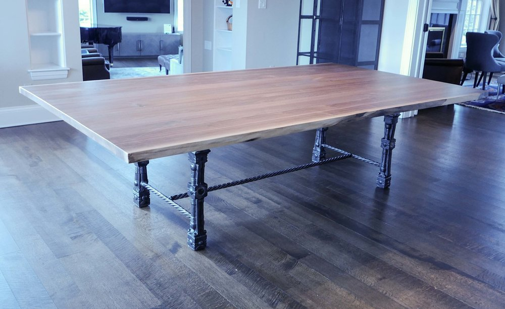 LIVE EDGE WALNUT TABLE - Salvaged urban trees were used to create this large 60 x 108 dining table. The base was fashioned from salvaged antique cast iron railing posts along with some new metal materials.