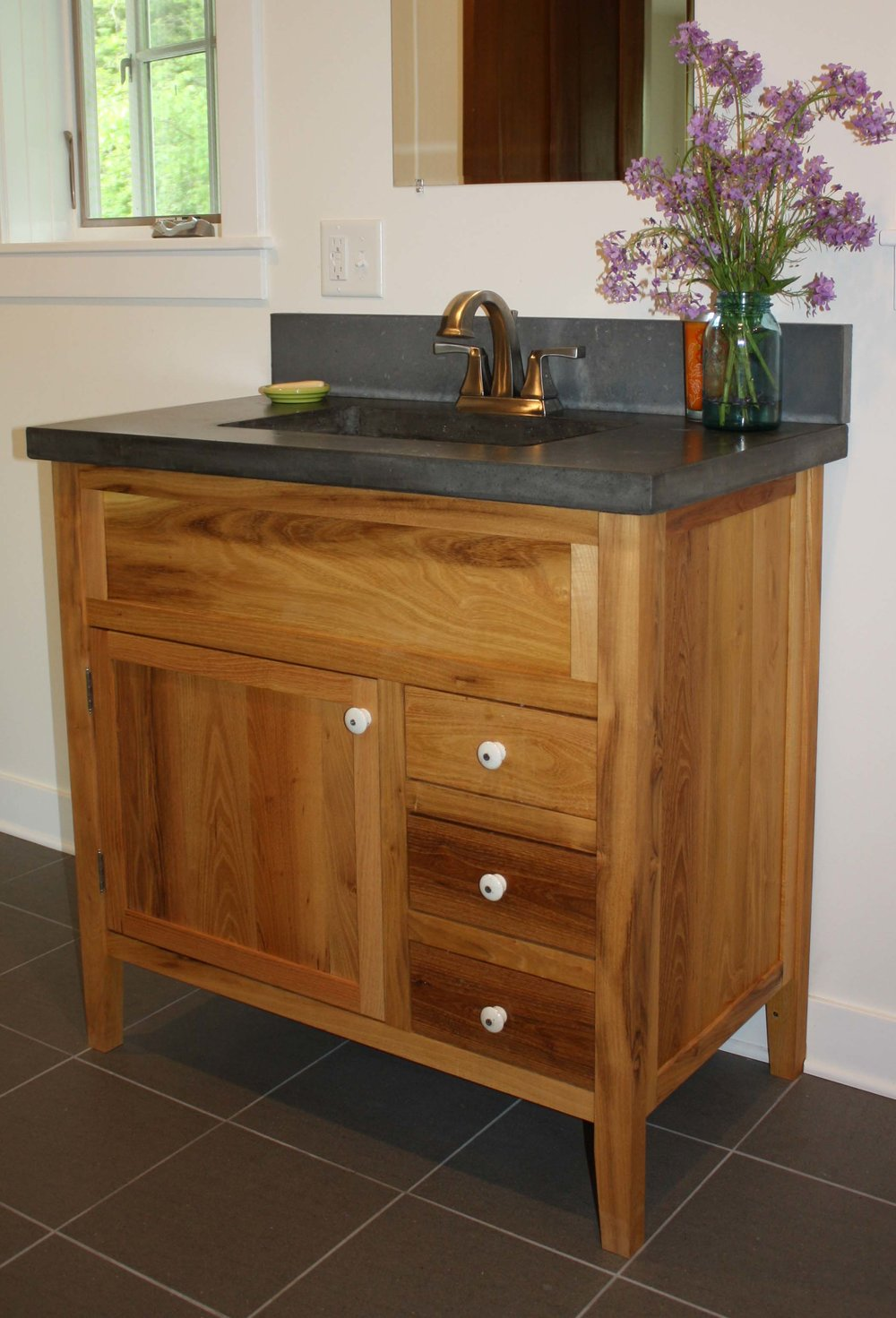 BATH VANITY - The design was influenced by 'Hoosier Cabinets' common in kitchen of the early 20th century. Solid black locust wood and an oil finish adds a warmth to the space.