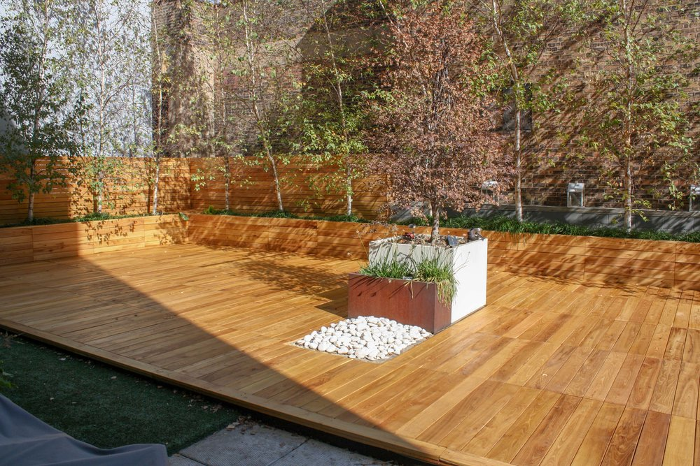RESIDENTIAL ROOF DECK - Black locust was used to remake this residential roof garden. Deck panles, planter fronts and fence sections were all replaced.