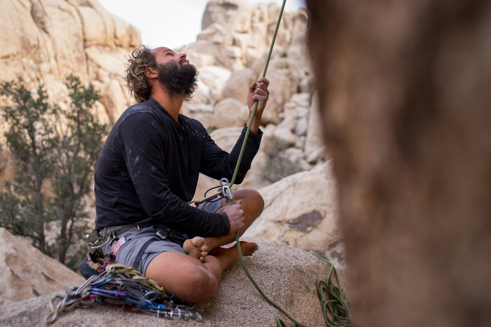 Lance, 32, has been climbing in Joshua Tree since December, even though the legal limit is 14 days. He spends his time climbing, socializing, and playing guitar. He is a avid cook, known for his ability to make fresh sourdough bread and cultured yoghurt from used milk jugs, plastic bags, and a dutch oven.