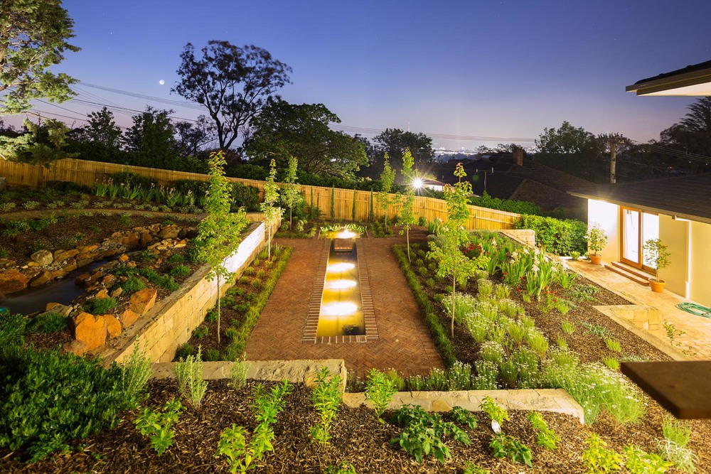 The layered garden foxys landscapes for Landscape design canberra