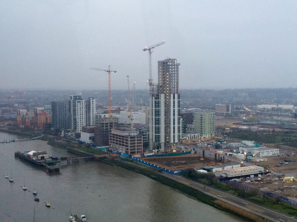 Latest construction progress on the Lower Riverside, as seen from Emirates Air Line cable car. Ground works are now underway on plot M0121, the future residential block north of The Waterman - April 2016 [ @greenpenlondon ]