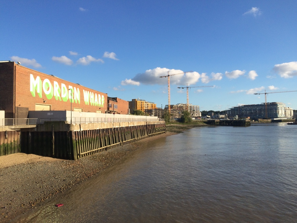 Existing industrial building on the Morden Wharf site facing onto the Thames - Sept 2015 [ @greenpenlondon ]