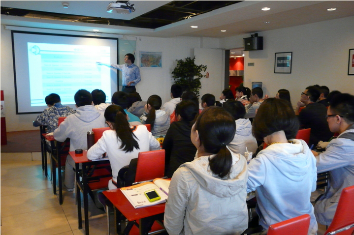 David Weeks teaching a debate concept to student in Chengdu