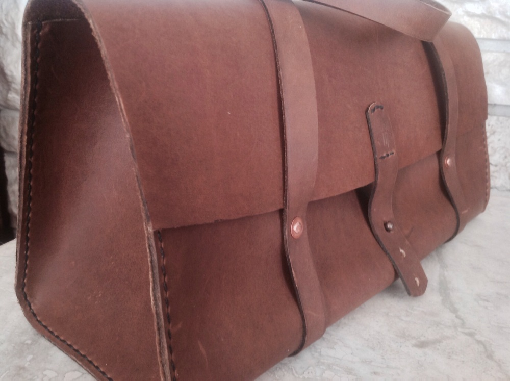 The same bag but with copper rivets, the full stitching, and a button stud.