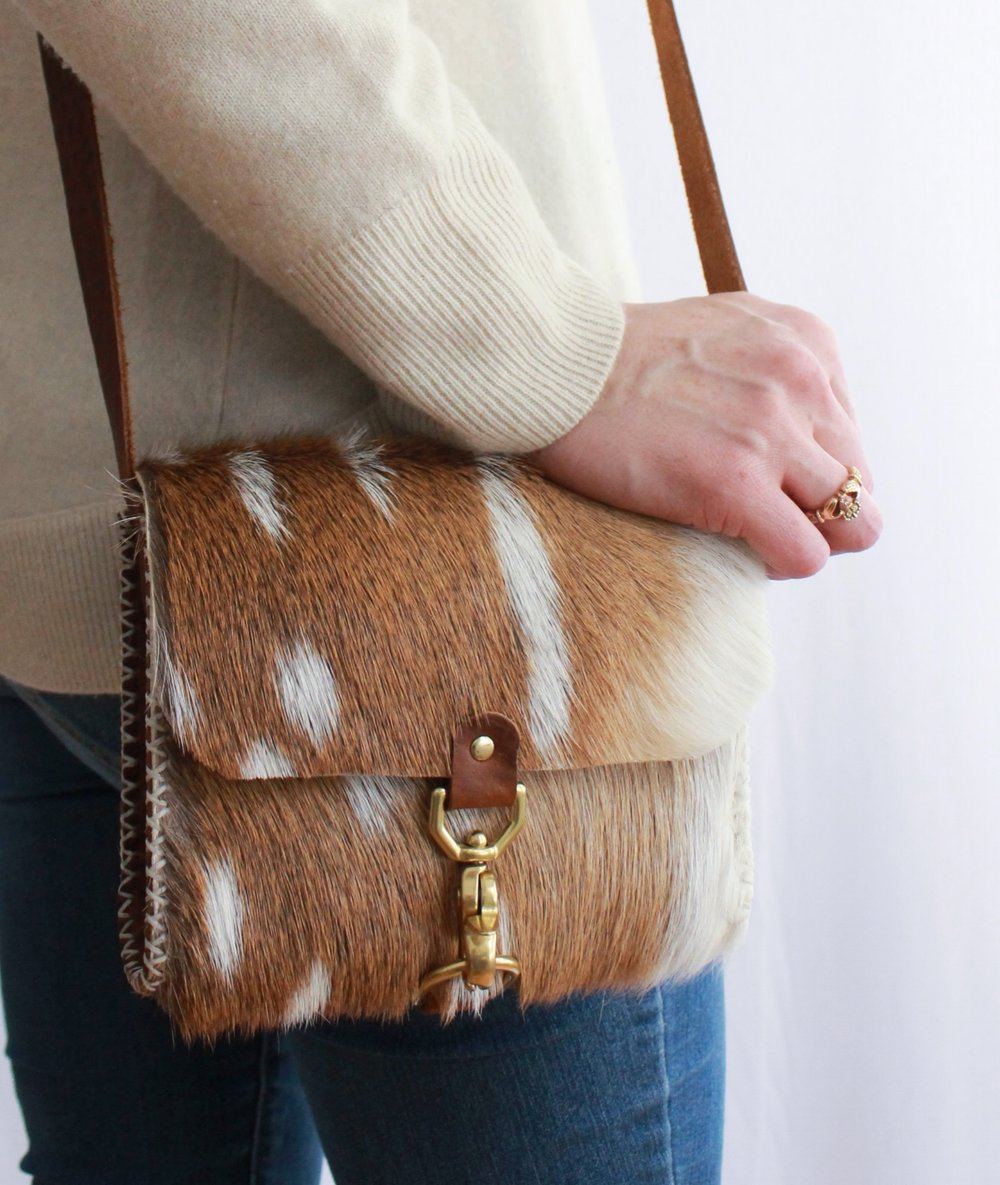 This smaller Axis purse with solid brass hardware is a perfect as an everyday carry purse.  The cross-body strap is adjustable, and the size is just right for the essentials.