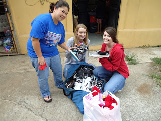 Distributing donated shoes, clothing and toys...