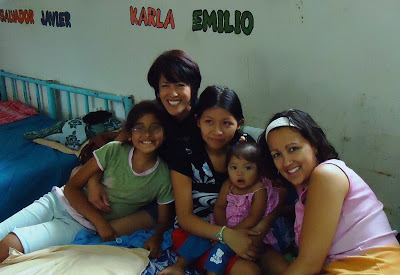 Susan, her daughter Julia and me ministering to a young mom at the government orphanage in El Salvador