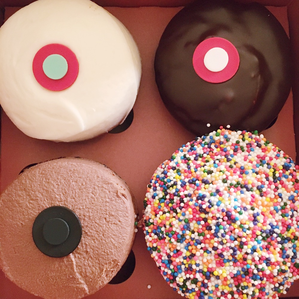 Yes, Sprinkles cupcakes bring me joy. And that one in the bottom left corner is a limited edition Black Velvet cupcake--a little bit of super dark chocolate heaven.