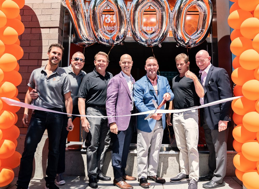 Ribbon cutting at Orangetheory Goat Blocks, the 1000th studio with the Orangetheory executive team!