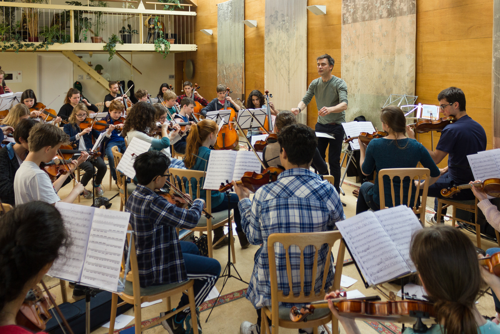 The 2015 orchestra rehearsing at Marryat Road with Leandro Silvera