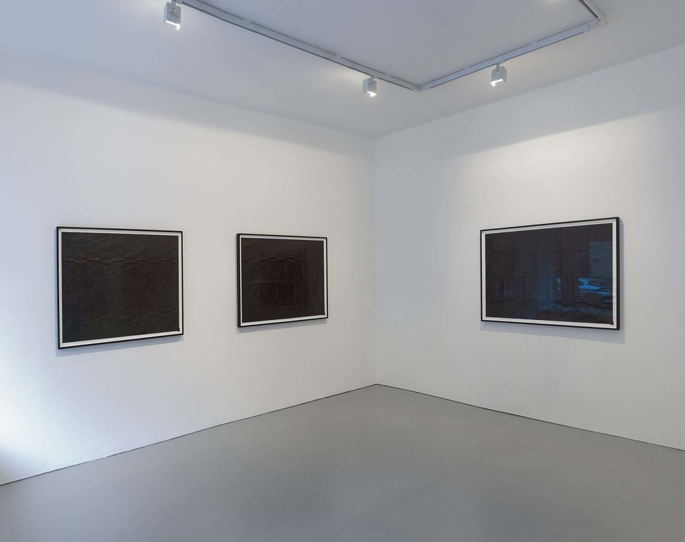 Installation shot of The Black Map Series 2010 at PEER Left and back walls of gallery