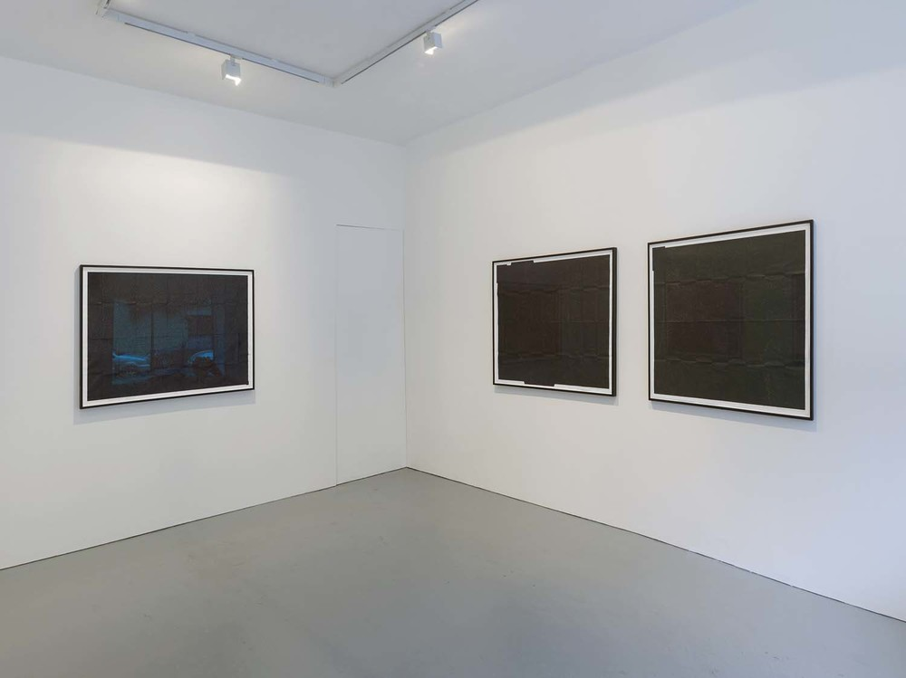 Installation shot of The Black Map Series 2010 at PEER Back and right walls of gallery