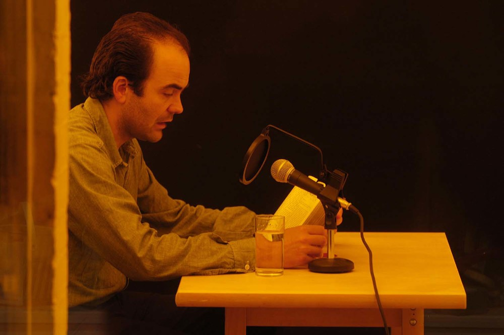 Juan Cruz during performance of Juan Cruz is translating Don Quijote (again) at PEER in 2005