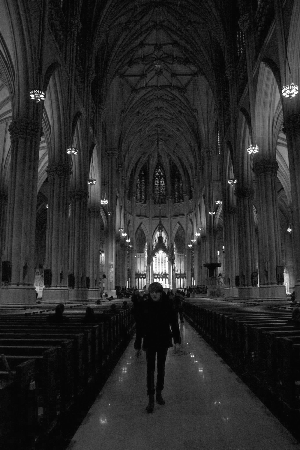 Christopher Campbell (Me) walking in the nave of St Patricks Cathedral, NYC.