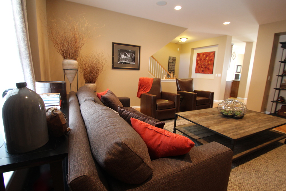 staging, living room, rustic decor, orange accents, reclaimed wood, leather seating