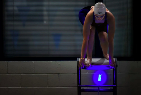 Gallaudet swimmer Faye Frez-Albrecht takes her mark on a starting block outfitted with a Reaction Light System, which helps level the field between hearing and non-hearing competitors. (Katherine Frey/The Washington Post)