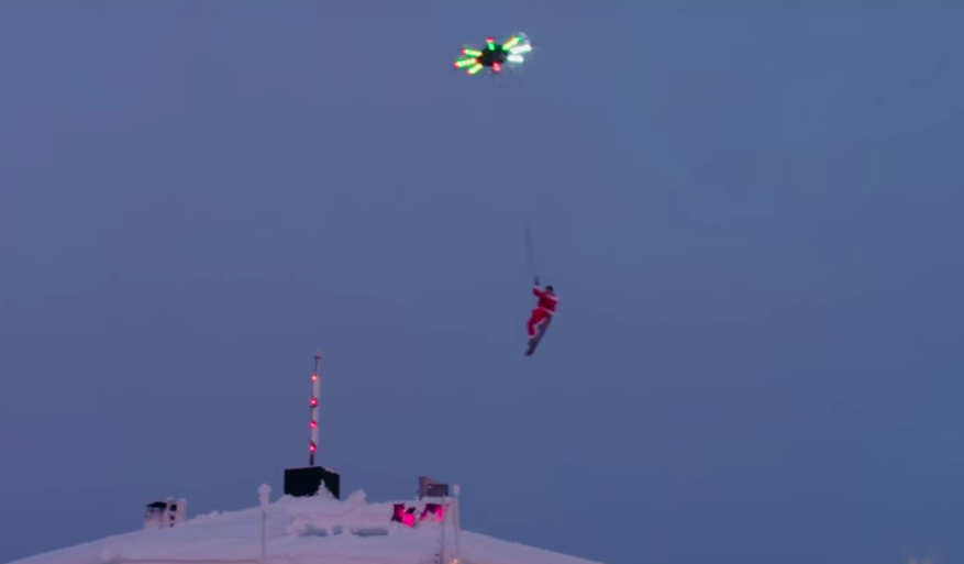 Casey Neistat flies over a Finnish chalet attached to a drone he helped make. (Screen capture via YouTube)